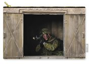 Canadian Army Soldier Conducts Military Carry-all Pouch by Stocktrek Images