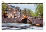 Canal Bridge And Boat Tour In Amsterdam At Evening Carry-all Pouch