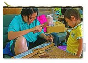 Child Watches As Mom Works In Teak Wood Carving Shop In Kanchanaburi-thailand Carry-all Pouch