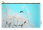 Close-up Dandelion Seeds Against Blue Carry-all Pouch