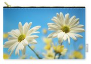 Close-up Of Daisies Against A Blue Carry-all Pouch