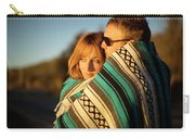 Couple Wraps Themselves In A Blue Carry-all Pouch