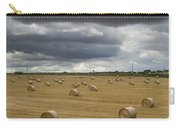 Dark Storm Clouds Over A Field With Hay Carry-all Pouch