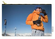 Dressed In Orange, A Skier Sips A Warm Carry-all Pouch