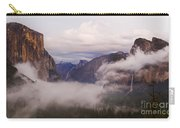 El Capitan Rises Over The Clouds Carry-all Pouch
