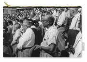 Fans At Yankee Stadium Stand For The National Anthem At The Star Carry-all Pouch by Underwood Archives