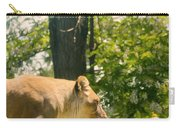 Female Lion On The Move Carry-all Pouch