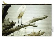 Great Egret On A Fallen Tree Carry-all Pouch by Joan McCool