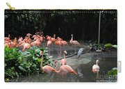 Group Of Flamingos And Lone Heron In Water Carry-all Pouch