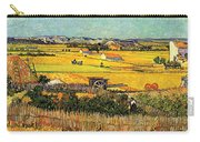 Harvest At La Crau With Montmajour In The Background Carry-all Pouch by Vincent Van Gogh