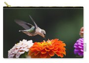 Hummingbird In Flight With Orange Zinnia Flower Carry-all Pouch by Christina Rollo