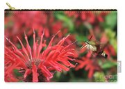 Hummingbird Moth Feeding On Red Flower Carry-all Pouch by Dan Friend