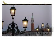 Lampposts Lit Up At Dusk With Building Carry-all Pouch