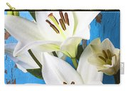 Lilies Against Blue Wall Carry-all Pouch