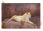 Lioness On A Red Rock Carry-all Pouch