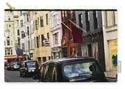 London Taxi On Shopping Street Carry-all Pouch by Elena Elisseeva