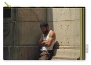 Man Leaning Against Wall In Sun Carry-all Pouch