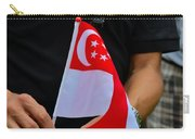Man Plants Singapore Flag On Bicycle Carry-all Pouch