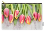 Many Spring Tulip Flowers On White Wood Table Carry-all Pouch