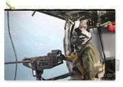 Naval Aircrewman Mans A .50-caliber Carry-all Pouch