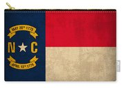 North Carolina State Flag Art On Worn Canvas Carry-all Pouch by Design Turnpike
