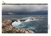 Wild Rocks At North Coast Of Minorca In Middle Of A Wild Sea With Stormy Clouds Carry-all Pouch