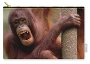 Orangutan Hanging On Tree Carry-all Pouch
