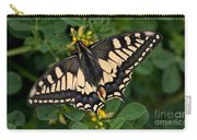 Papilio Machaon Butterfly Sitting On The Lucerne Plant Carry-all Pouch
