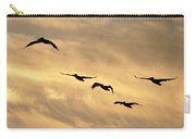 Pelicans Against A Golden Sky Carry-all Pouch