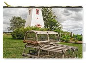 Prince Edward Island Lighthouse With Lobster Traps Carry-all Pouch by Edward Fielding