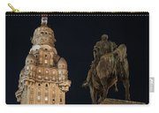 Public Statue And Skyscraper At Night Carry-all Pouch