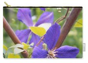 Purple Clematis Clinging On A Fence Carry-all Pouch