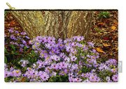 Purple Flowers At Base Of Tree Carry-all Pouch