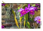 Purple Orchids With Cultured Stone Background Carry-all Pouch by Alex Grichenko