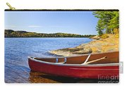 Red Canoe On Shore Carry-all Pouch by Elena Elisseeva