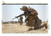 Rifleman Kneels To The Ground While Carry-all Pouch