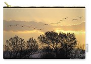 Sandhill Cranes Flying At Sunset Carry-all Pouch