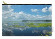 Scenic View Of A Lake Against Cloudy Carry-all Pouch