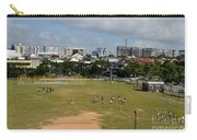 Schoolchildren Practicing On Playing Field With Singapore Skyline In Background Carry-all Pouch