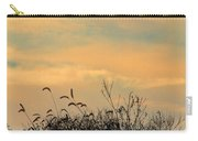 Silhouette Of Grass And Weeds Against The Color Of The Setting Sun Carry-all Pouch