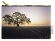 Silhouetted Tree In Field Sunrise Carry-all Pouch
