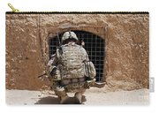 Soldier Searches A Compound Carry-all Pouch by Stocktrek Images