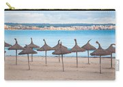 Straw Umbrellas On Empty Beach Carry-all Pouch