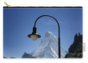 Street Lamp And Mountain Carry-all Pouch by Mats Silvan