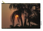 Sun Setting Behind The Queen Palm Covered In Smoke Carry-all Pouch