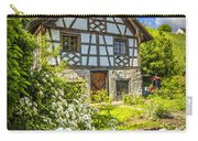 Swiss Chalet In The Garden Carry-all Pouch by Debra and Dave Vanderlaan