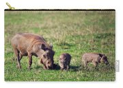 The Warthog Family On Savannah In The Ngorongoro Crater. Tanzania Carry-all Pouch