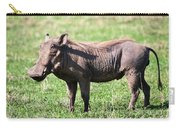 The Warthog On Savannah In The Ngorongoro Crater. Tanzania Carry-all Pouch