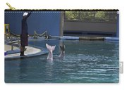 Trainer And The Tails Of A Duo Of Dolphins At The Underwater World Carry-all Pouch