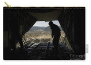 U.s. Air Force Airman Pushes Carry-all Pouch by Stocktrek Images